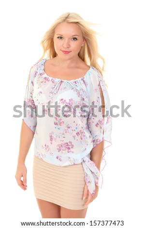 Pretty young blonde in a light summer blouse