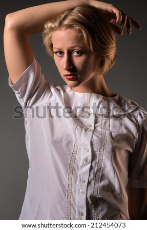 Pretty young blonde in a white lace blouse