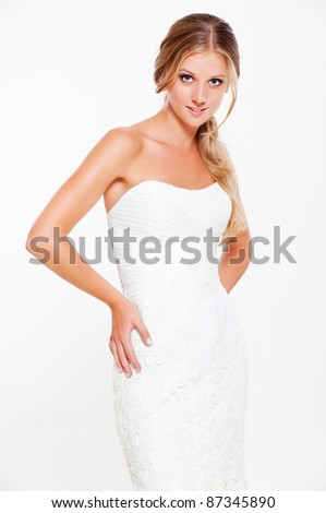pretty young blonde in white dress posing - stock photo