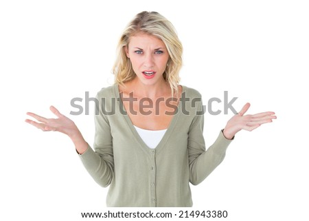 Pretty young blonde looking confused on white background - stock photo