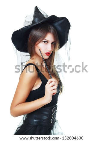 pretty young brunette witch, isolated against white background  - stock photo