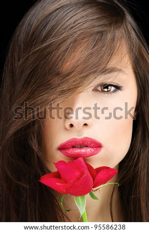Pretty young brunette woman and red rose - stock photo