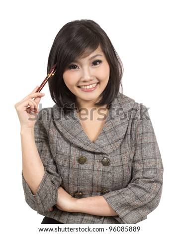 pretty young business woman holding pen against her head - stock photo