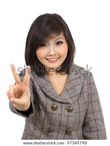 pretty young business woman making victory sign - stock photo