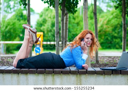Pretty young business woman  using mobile phone. - stock photo
