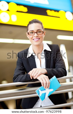 pretty young businesswoman at airport - stock photo