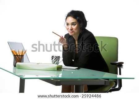 Pretty young businesswoman sitting at her office desk