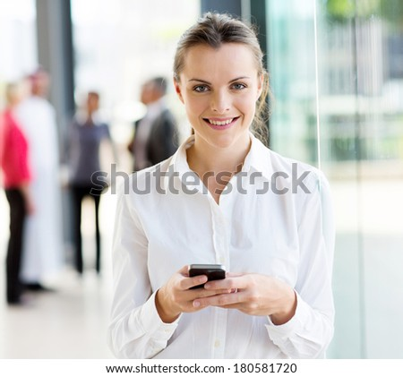 pretty young businesswoman using smart phone - stock photo