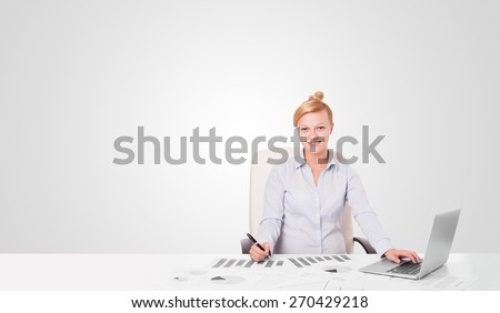 Pretty young businesswoman with plain white copy space - stock photo