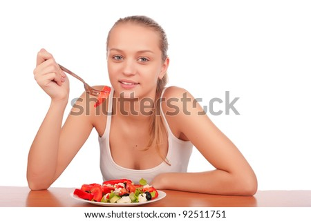 pretty young caucasian woman eat vegetable salad, young healthy fitness woman on diet and eat vegetarian salad, woman eating salad,isolated on white background image