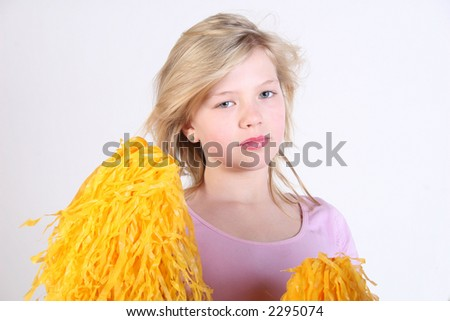 Pretty young cheerleader - stock photo