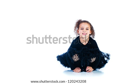 Pretty young child wearing a black dress - stock photo