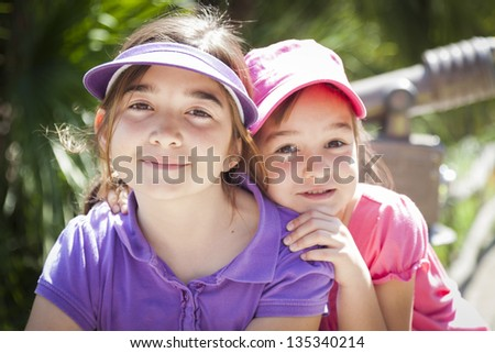 Pretty Young Children Sisters Portrait Outside. - stock photo