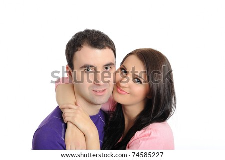 pretty young couple in love embracing. isolated on white background