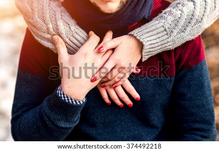 Pretty young couple outdoor in the park - stock photo