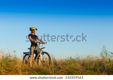 pretty young female biker outdoors on her mountain bike