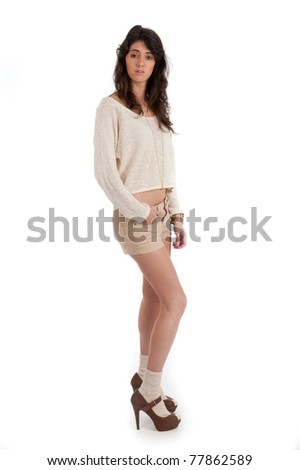 Pretty young female casual isolated against white