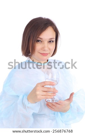 pretty young female doctor with the glass in her hand