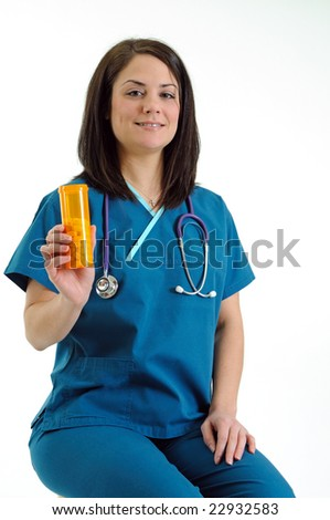 Pretty young female nurse or doctor seated and holding pill bottle - smiling