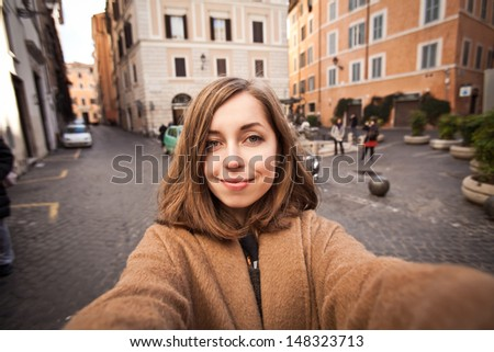 Pretty young female tourist in Europe