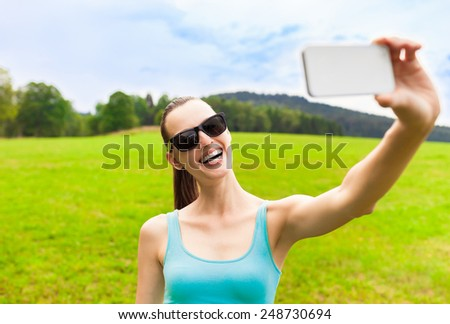 Pretty young female tourist takes travel selfie in Europe - stock photo