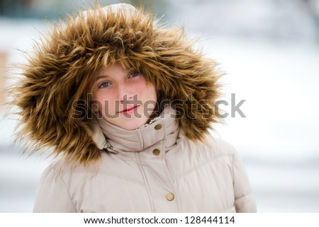 Pretty young girl bundled up for the snow - stock photo