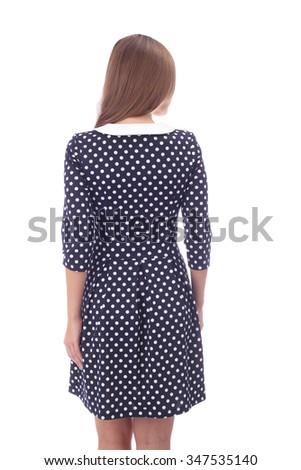 pretty young girl demonstrating polka dot dress - stock photo