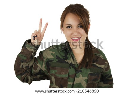 Pretty young girl dressed in green military uniform gesturing peace sign isolated on white - stock photo
