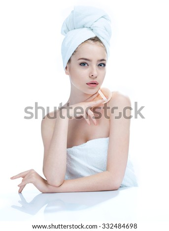 Pretty young girl enjoy a flawless skin, skin care concept / photo composition of blonde girl in towel - isolated on white background - stock photo