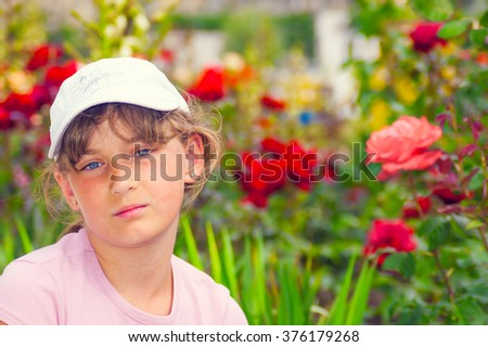 Pretty young girl in garden - stock photo