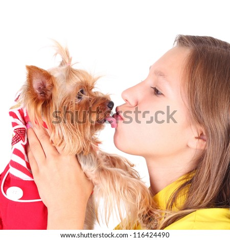 pretty young girl kissing her cute little dog