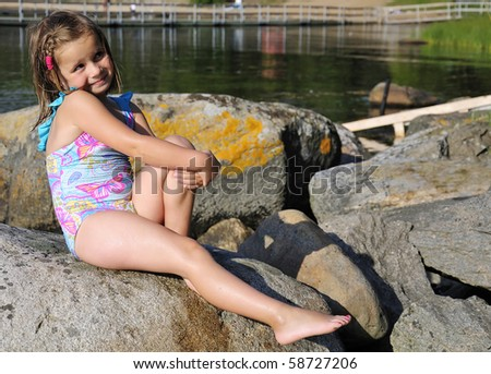 Pretty young girl like a sea coast model - stock photo