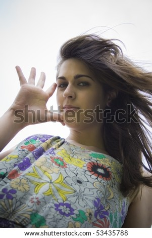 pretty young girl looking at the camera with a look fun - stock photo