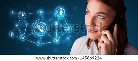 Pretty young girl making phone call with social network icons