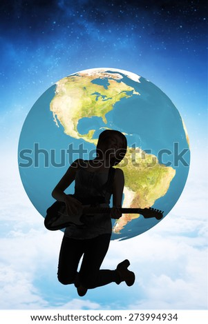 Pretty young girl playing her guitar against white clouds under blue sky - stock photo