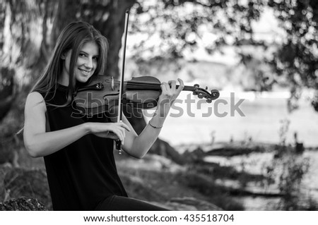 Pretty young girl playing violin
