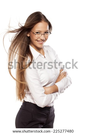 pretty young girl poses with the wind in her hair - stock photo
