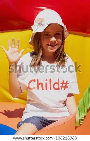 Pretty young girl posing outdoors in a bright sunny day with beautiful smile - stock photo