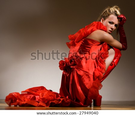Pretty young girl's back partly covered by red dress