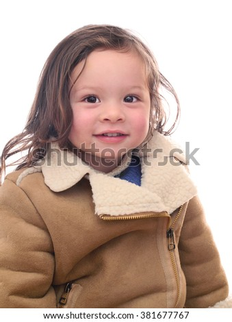 Pretty Young Girl Smiling Wearing a Coat