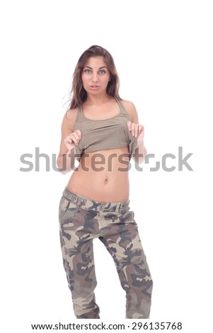 pretty young girl taking her top off - stock photo
