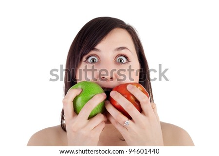 pretty young girl trying to eat two apples at the same time - stock photo