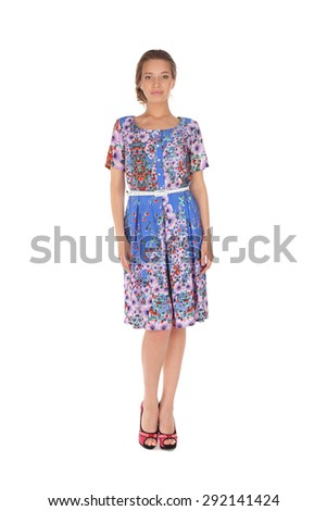 pretty young girl wearing a flower printed dress - stock photo
