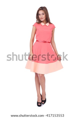 pretty young girl wearing a pink dress