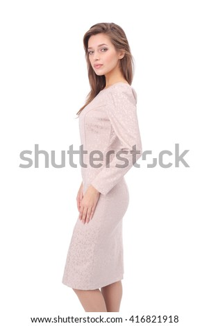 pretty young girl wearing beige printed dress - stock photo