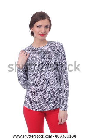 pretty young girl wearing blue and white printed blouse with the red pants - stock photo