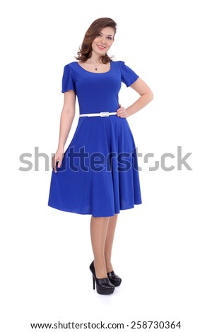 pretty young girl wearing blue dress with the white belt - stock photo