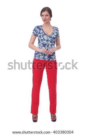 pretty young girl wearing blue floral printed top with the red pants - stock photo