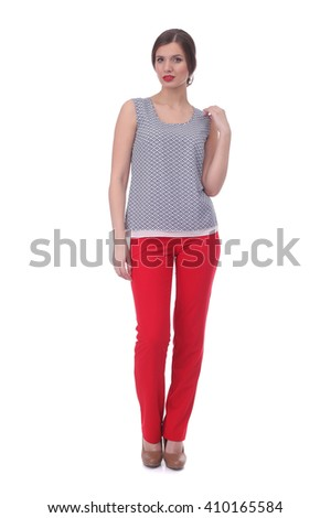 pretty young girl wearing blue printed top with the red pants - stock photo