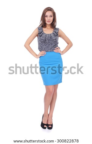 pretty young girl wearing blue skirt and jabot top - stock photo
